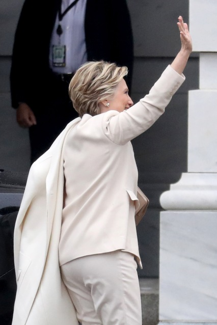 WASHINGTON, DC - JANUARY 20: Hillary Clinton waves as she arrives at the U.S. Capitol on January 20, 2017 in Washington, DC. In today's inauguration ceremony Donald J. Trump becomes the 45th president of the United States. (Photo by Rob Carr/Getty Images)